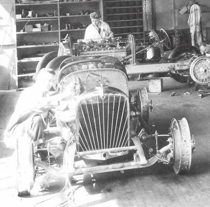 indy cars in shop 1932 with bird rad caps